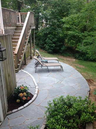 Eastham Cape Cod vacation rental - Bluestone patio with lounge chairs overlooking the pond