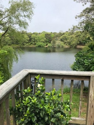 Eastham Cape Cod vacation rental - View of Schoolhouse Pond from the deck with dining table.