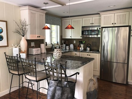 Eastham Cape Cod vacation rental - Fully renovated kitchen with breakfast bar.