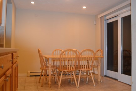 Falmouth, Teaticket Cape Cod vacation rental - Dining area / Eat-in Kitchen with sliders to the back deck