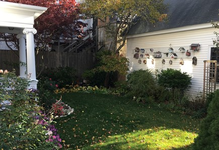 Provincetown Cape Cod vacation rental - Side garden with all our birdhouses