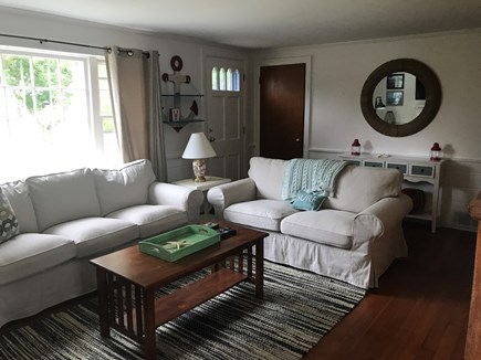 Dennis Port Cape Cod vacation rental - Living Room with Sofa, Loveseat, Cable Television, and games.