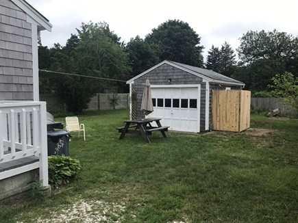 Dennis Port Cape Cod vacation rental - Back Yard with picnic table, grill and bean bag toss.