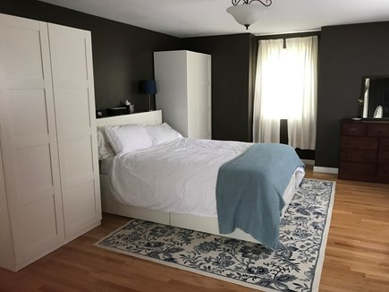Mashpee Cape Cod vacation rental - Front to back master bedroom with queen sized bed