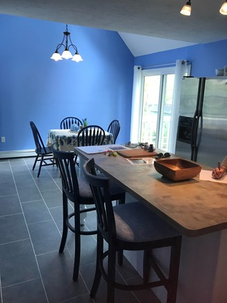 Mashpee Cape Cod vacation rental - Expansive kitchen with center island and bar stools