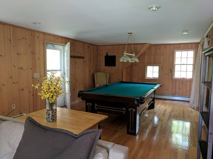 Harwich Cape Cod vacation rental - Open living space in the room above garage with pool table.