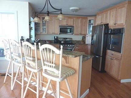 Chatham Cape Cod vacation rental - Kitchen with breakfast bar and open floor plan and views.