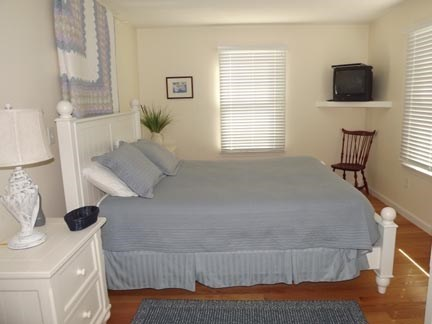 Chatham Cape Cod vacation rental - First floor queen bedroom with bathroom en suite and views.