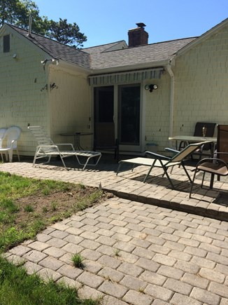 West Yarmouth Cape Cod vacation rental - Back patio with French doors, seating for six with gas grill.