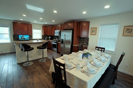 Hyannis Cape Cod vacation rental - Dining area has slide door to deck, open to kitchen