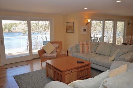 Orleans Cape Cod vacation rental - Main floor living room lots of light - slider to deck