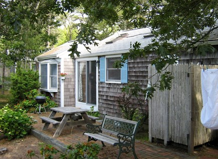 South Chatham Cape Cod vacation rental - Back of cottage with picnic table & outdoor shower