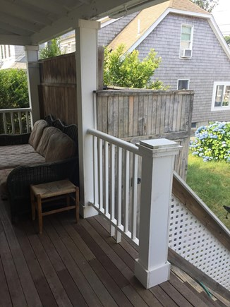 Harwichport Cape Cod vacation rental - Rear deck with picnic table on the lawn and a charcoal grill