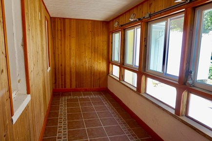 North Falmouth Cape Cod vacation rental - Sun room overlooking backyard and swing set