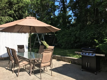 North Falmouth Cape Cod vacation rental - Patio with BBQ & swing set