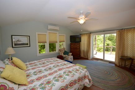 Orleans Cape Cod vacation rental - Master bedroom with sliders to deck and Flat Screen TV