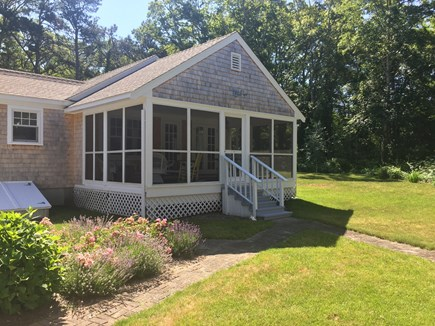 East Orleans Cape Cod vacation rental - Comfortable and roomy screened porch overlooks private back yard