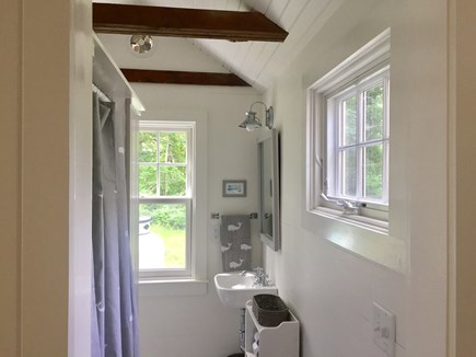 East Orleans Cape Cod vacation rental - Bathroom with shower that has a floor with Nauset Beach stones