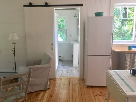 East Orleans Cape Cod vacation rental - Vintage bathroom has a sliding barn door & whitewashed pine floor