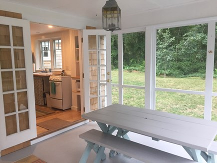 East Orleans Cape Cod vacation rental - French doors in kitchen open to dining area on screened porch