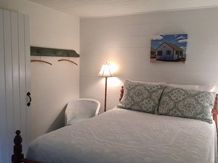 East Orleans Cape Cod vacation rental - Cozy front bedroom with antique double bed and original floor.