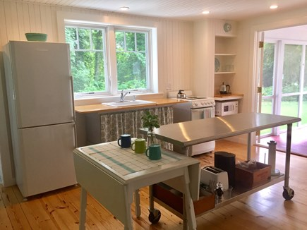 East Orleans Cape Cod vacation rental - Sunny, open kitchen has plenty of work space & opens to the porch