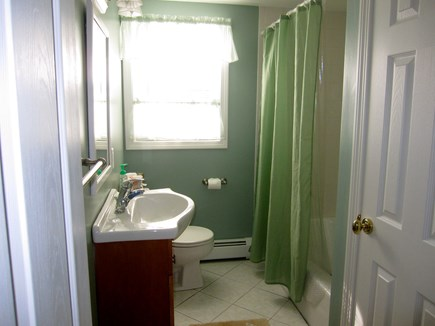 West Dennis Cape Cod vacation rental - Main bath with tub/shower.  Tile floor and large linen closet
