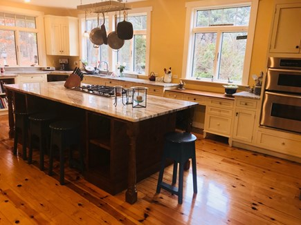 Wellfleet Cape Cod vacation rental - Chefs kitchen seating and cooking at the island.