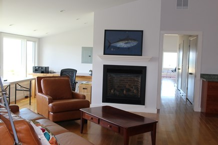 Truro Cape Cod vacation rental - Master suite sitting room, gas fireplace, TVwet bar, couches desk