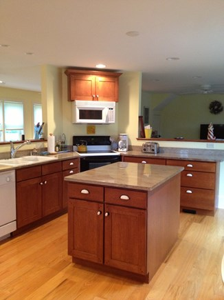 Dennis Cape Cod vacation rental - Yellow side kitchen with dishwasher, microwave and electric stove