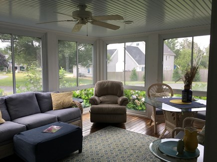 Dennis Cape Cod vacation rental - Sunroom looking out on the beautiful Willow trees again.