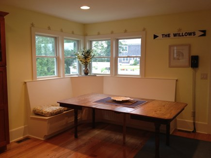Dennis Cape Cod vacation rental - Kitchen dining area. Bench seat at the back for family meals