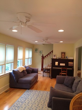 Dennis Cape Cod vacation rental - Long Sunroom that has 8 windows looking out at the Willows trees.