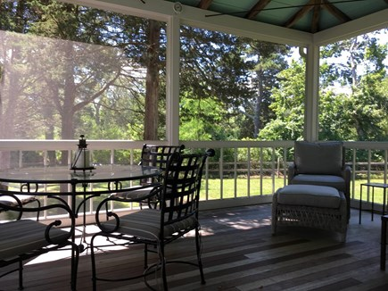 Dennis Cape Cod vacation rental - Large, private screened porch with dining and sitting areas