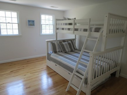 Harwich Cape Cod vacation rental - Bunk room has full double under twin, plus trundle bed.