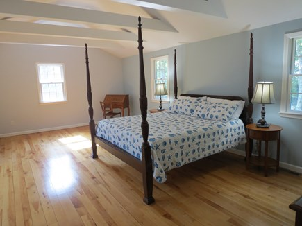 Harwich Cape Cod vacation rental - Upper level master bedroom with four-poster king size bed.