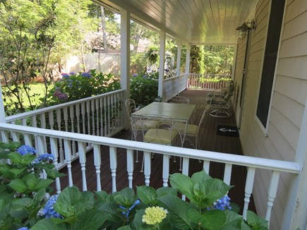 Harwich Cape Cod vacation rental - Farmer's porch provides comfy additional outdoor living space.