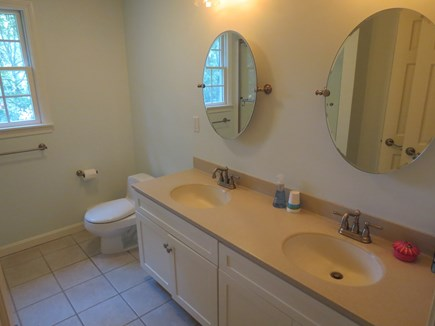 Harwich Cape Cod vacation rental - Roomy, bright master bath with double sink vanity.