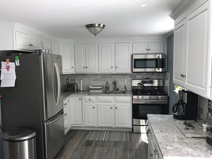 Falmouth Cape Cod vacation rental - Eat in kitchen with gas stove, fridge with ice maker