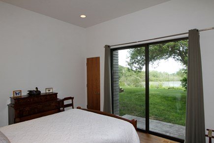 Brewster Cape Cod vacation rental - Slider with access to a sitting area and an outdoor shower