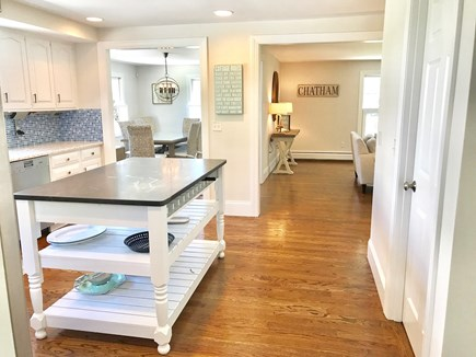 Chatham (in town) Cape Cod vacation rental - Walking into kitchen from sun room - view of LR & DR