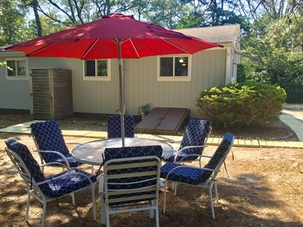 Eastham Cape Cod vacation rental - Shaded outdoor dining, outdoor shower, private yard