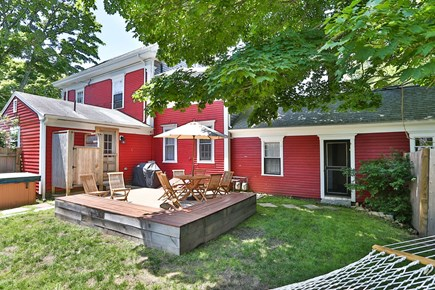 Harwich Center Cape Cod vacation rental - Fully fenced back yard has an outdoor shower fire pit and hot tub