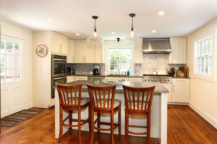 Harwich Center Cape Cod vacation rental - A view of the kitchen showing the island