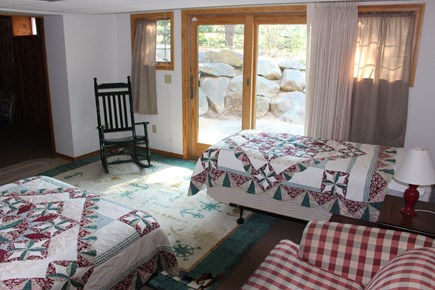Eastham Cape Cod vacation rental - Basement. Full/Twin, bathroom, 25 x 14 carpeted room, and patio.
