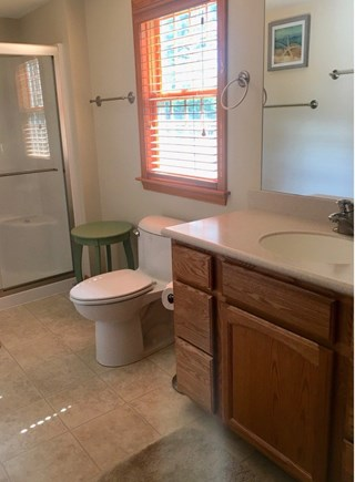 Eastham Cape Cod vacation rental - Master Bath with two vanities/sinks, and walk-in shower.