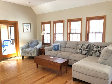 Eastham Cape Cod vacation rental - Family room with new couch. Ceiling fan in vaulted ceiling.