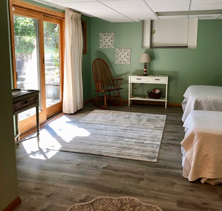 Eastham Cape Cod vacation rental - Basement room with walkout to patio, full and twin beds.