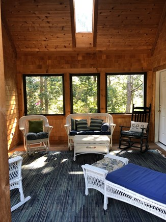 Eastham Cape Cod vacation rental - Screened porch oasis! All cedar lined with a ceiling fan.