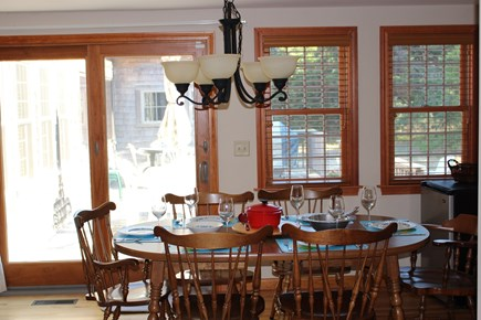 Eastham Cape Cod vacation rental - Extra leaves increase seating to 10. Mini-fridge is on the right.